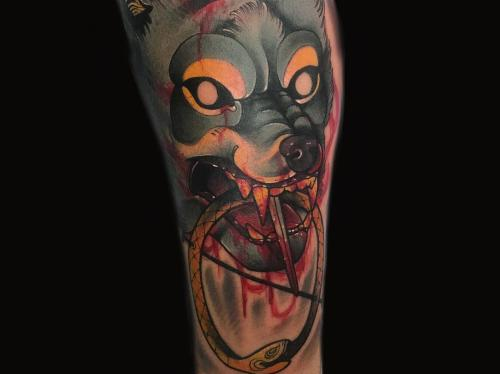 Neotraditional-Wolf-tattoo -wolf-and-dagger-tattoo